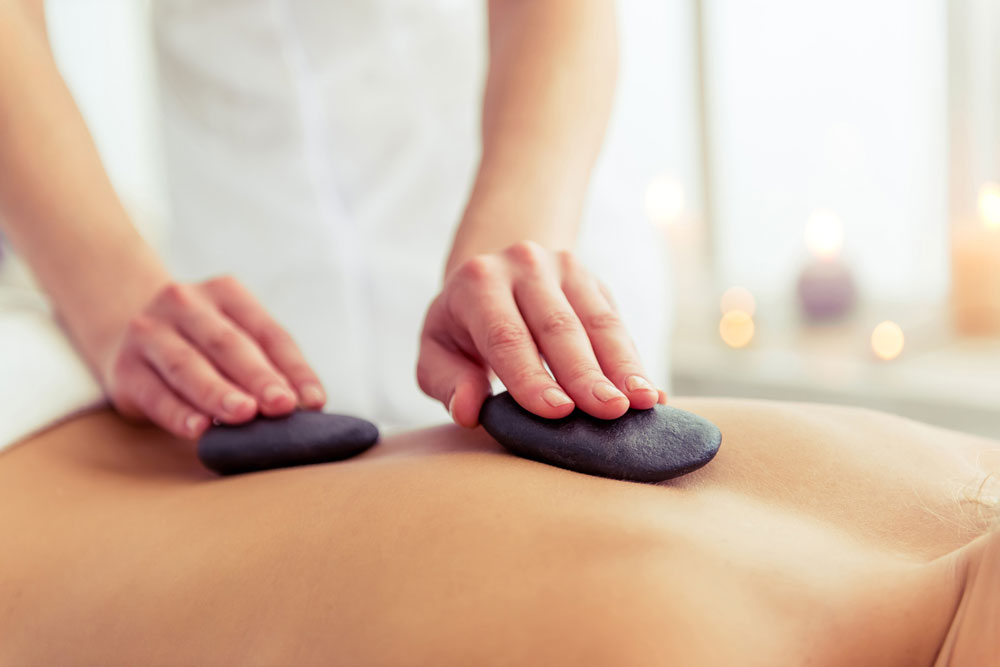 Hot Stone Massage | Waterloo, ON | Soul City Health & Wellness
